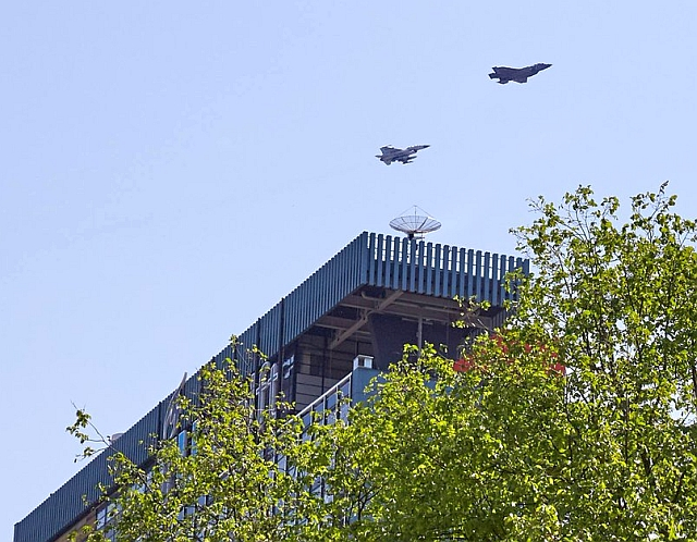 F-35 and F-16 fighters above the EWI building